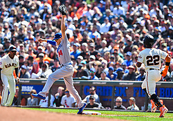 April 8, 2018 - San Francisco, California, U.S. - SAN FRANCISCO, CA - APRIL 08: Los Angeles Dodgers Infield Enrique Hernandez (14) completes the play for a first base out against San Francisco Giants Pitcher Cory Gearrin (26) during a regular season game between the Los Angeles Dodgers and San Francisco Giants on April 8, 2018, at AT&T Park in San Francisco, CA. (Photo by Stephen Hopson/Icon Sportswire) (Credit Image: © Stephen Hopson/Icon SMI via ZUMA Press)