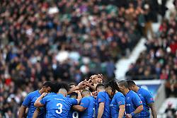Samoa players form a huddle before the Autumn International at Twickenham Stadium, London.