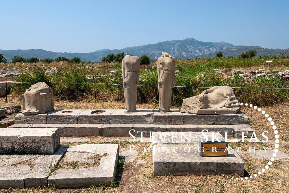 Iraion. Samos. Greece. View of the copy of the statue group by the great 6th century sculptor Genelos.  Dating from 560 - 550 B.C, the steeped pedestal originally contained 6 statues of which four have survived. The statues are representing a father, mother and children are of a distinguished family of the time.  Each of the figures has an inscription stating its name. The work displays interesting innovations that influenced the art of Ionia.