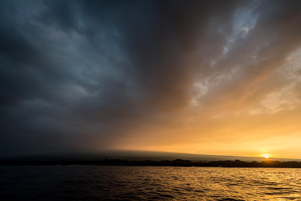 Sunrise over Kona, the Big Island, Hawaii.  Photo © William Drumm, 2013.