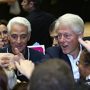 Former President Bill Clinton (R) and Florida Democratic gubernatorial candidate Charlie Crist shake hands with supporters after finishing a campaign event on Monday, Nov. 3, 2014, at the UCF Arena in Orlando, Fla. Crist, a former Florida Republican governor, is running against Republican Florida Gov. Rick Scott.  (AP Photo/Alex Menendez)
