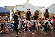 From left to right, Jenna Kafeety, 11, Maya Zoumut, 12, Sabrina Nijmeh, 12, and Giselle Swaiss, 11, of the St. James Orthodox Church Youth Group perform during the Middle Eastern & Greek Food Fest at St. James Orthodox Church in Milpitas, California, on September 14, 2014. (Stan Olszewski/SOSKIphoto)