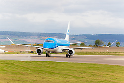 Inverness Airport welcomed KLM's Inaugural flight from Amsterdam. To celebrate the new route, the first flight from Schiphol, Amsterdam was greeted by a water cannon salute upon arrival.  On board were Barry ter Voert, Senior Vice President, Air France KLM European Markets and Wilco Swejen, Director for Aviation Marketing, Schipol Airport.  Provost Helen Carmichael, The Highland Council, Inglis Lyon, Managing Director of Highlands and Islands Aiports and Drew Hendry MP (Inverness, Nairn, Badenoch and Strathspey) met the delegation, officially welcoming the group to the Highlands. <br /> <br /> Pictured: KLM aircraft arrives<br /> <br /> Malcolm McCurrach | EEm | Tue, 17, May, 2016