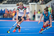 Surbiton's Sarah Haycroft is watched by Rebecca Condie playing kicking back for University of Birmingham. University of Birmingham v Surbiton - Semi-Final - Investec Women's Hockey League Finals, Lee Valley Hockey & Tennis Centre, London, UK on 22 April 2017. Photo: Simon Parker
