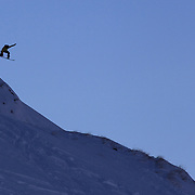 Freerider Will Bromelski of the United States launches off a drop  during the World Heli Challenge Freestyle Day at Mount Albert on Minaret Station, Wanaka, New Zealand. 31st July 2011