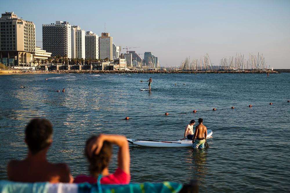Paddleboarders are seen at the Mediterranean Sea near Hilton Beach in Tel Aviv, Israel, on July 21, 2015.