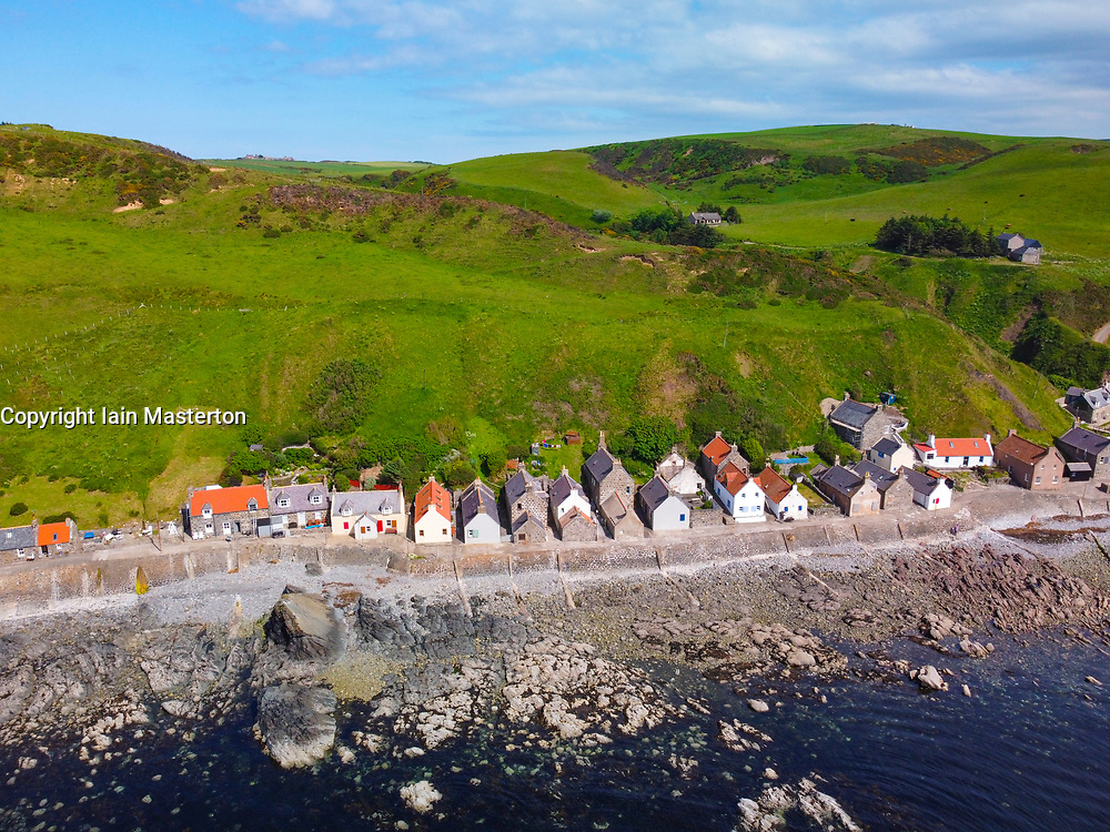Aerial view from drone of houses in village of Crovie on Moray Firth coast in Aberdeenshire, Scotland, UK