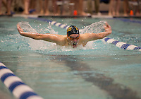 Bishop Brady's Austin Schinlever competes in the 100 year Butterfly at UNH Sunday morning during the NHIAA Division II Swimming and Diving Championships.  (Karen Bobotas/for the Concord Monitor)