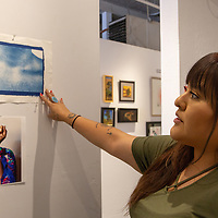 Hannah Manuelito the artist in residence at Art123 Gallery in Downtown Gallup shows some of the work she has  done that is hangning in her studio space Tuesday afternoon June 19, 2018.