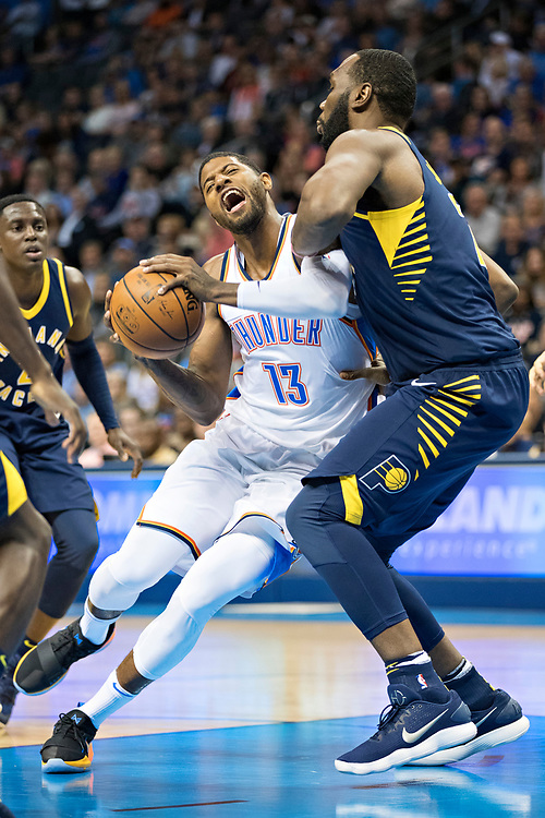 OKLAHOMA CITY, OK - OCTOBER 25:  Paul George #13 of the Oklahoma City Thunder drives to the basket during a game against the Indiana Pacers at the Chesapeake Energy Arena on October 25, 2017 in Oklahoma City, Oklahoma.  NOTE TO USER: User expressly acknowledges and agrees that, by downloading and or using this photograph, User is consenting to the terms and conditions of the Getty Images License Agreement.  The Thunder defeated the Pacers 114-96.  (Photo by Wesley Hitt/Getty Images) *** Local Caption *** Paul George