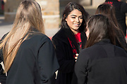 Iraan High School cheerleader Lauren Garlock visits with friends before getting on the busses to Arlington for the football state title game in Iraan, Texas on December 14, 2016. (Cooper Neill for The New York Times)