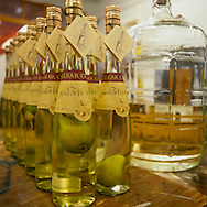 Small batch Eau de Vie de Poire by Clear Creek Distillery in Portland, Oregon with pears that are slowly becoming saturated with the apertif.