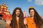 Shiv Giri, from USA and Shiva Giri, from Rusia. They are married in the real life and are brothers in the spiritual life. They belong to the Juna Akhara. Allahabad, February 2013 // The Maha Kumbh Mela is believed to be the single largest religious gathering in the world. It's a sacred pilgrimage celebrated every twelve years. In 2013 it has taken place in Allahabad, in the confluence of the rivers Ganga, Yamuna and Saraswati. Millions of hindu people gather on a single day for a ritual bath in the sacred waters of Ganga. The event congregate millions of devotees, sadhus and sadhvis of all the akharas coming from all over India.