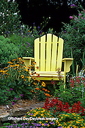 63821-14106 Yellow Adirondack chair in flower garden - Marion Co IL
