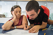 08/09/2015 - Lisbon, Portugal: Street artist Adres (Adrião Resende), 33, tries to motivate Lurdes Silva, 80,  by helping her in the drawing process. Mrs, Silva was not interested in the workshop in the beginning but by the end she was really interested in painting the wall. Lata 65 was project created by Lara Seixo Rodrigues and is a creative workshop teaching street art to senior citizens. (Eduardo Leal)