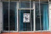 A poster explaining that beauty dies when litter is present is still stuck to the window of an abandoned building, on 8th October 2019, in Rainham, Essex, England. Voters in this Havering borough voted 69% in favour of Brexit during the 2016 referendum.