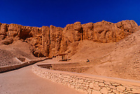 Tourists walking between the tombs, Valley of the Kings Archaeological site, near Luxor, Egypt