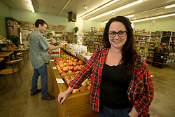 Corinne Kinczel, who will take over as the owner of Rocky's Market in the Oakmore neighborhood of Oakland, Calif., poses for a photograph in the grocery store, Thursday, April 7, 2016. Her partner, Brady Bellis, is at left. (D. Ross Cameron/Bay Area News Group)