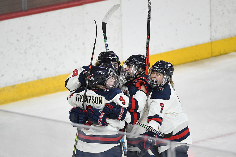 ERIE, PA - MARCH 06: Gillian Thompson #3 of the Robert Morris Colonials celebrates with teammates after scoring a goal in the first period during the CHA Tournament Championship game against the Syracuse Orange at the Erie Insurance Arena on March 6, 2021 in Erie, Pennsylvania. (Photo by Justin Berl/Robert Morris Athletics)
