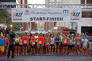Runners get ready for the start of the Children's Hospital of New Orleans' Jazz Marathon, October 6, 2013.