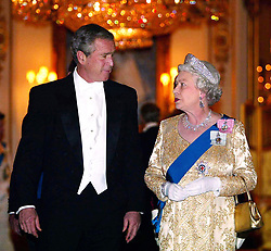 Britain's Queen Elizabeth II arrives with US President George Bush for the Buckingham Palace state banquet in honour of the US President, during the first day of his four day state visit to the U.K.   * The Queen told President George Bush that Britain and America stood firm in their determination to defeat terrorism.