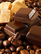 Pieces of cholate, coffee beans and sugar. Stock Photo