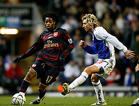 Photo: Paul Greenwood/Sportsbeat Images.<br />Blackburn Rovers v Arsenal. Carling Cup, Quarter Final. 18/12/2007.<br />Arsenal's Alex Song (L) takes the ball past the challenge of Robbie Savage
