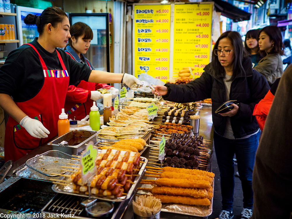 14 OCTOBER 2018 - SEOUL, SOUTH KOREA: A street food vender in the neighborhood around Myeongdong Street between the Cathedral and City Hall in Seoul. It's a high end shopping, dining and entertainment district, popular with tourists and wealthy South Koreans.     PHOTO BY JACK KURTZ