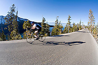 Cyclist on highway 89 above Emerald Bay. Lake Tahoe, CA<br />