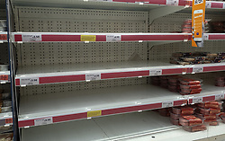 © Licensed to London News Pictures. 20/09/2021. London, UK. Nearly empty shelves of meat products in Sainsbury's in north London as fears of food shortages grow after two of the UK's biggest Carbon Dioxide (CO2) producers halted production last week due to soaring gas prices. Photo credit: Dinendra Haria/LNP