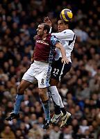 Photo: Ed Godden.<br /> Tottenham Hotspur v Aston Villa. The Barclays Premiership. 26/12/2006. Villa's Gavin McCann (L), is beaten to the ball by Tom Huddlestone.