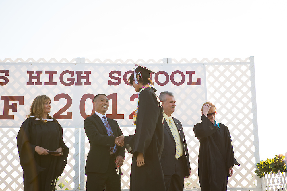 Cal Hills Class of 2012 senior Jonathan Medina receives his diploma and shakes the hand of Milpitas superintendent Cary Matsuoka at graduation on June 15, 2012, held at Milpitas High School, Milpitas, Calif.  Photo by Stan Olszewski/SOSKIphoto.