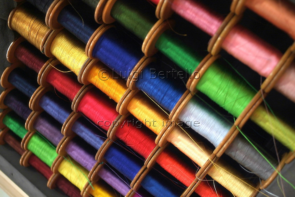 Colorful spools of cotton sewing thread