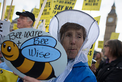 © Licensed to London News Pictures. 26/04/2013. London, UK. A beekeeper during Britain's 12 leading campaigning groups protest in Parliament Square, London on April 26, 2013. Over 100 beekeepers  from across the UK march on Parliament in opposition to the Government's plan to oppose a ban on bee killing pesticides in a crucial EU vote Monday. Photo credit : Peter Kollanyi/LNP