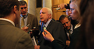 Senator John McCain R AZtalks to reporters about START  in the hall of the US Senate after the passage of the tax cut legislation in the Senate.  Photo by Dennis Brack