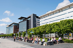 Office workers on lunch break at IFSD Broomielaw new business and financial district in Glasgow United Kingdom