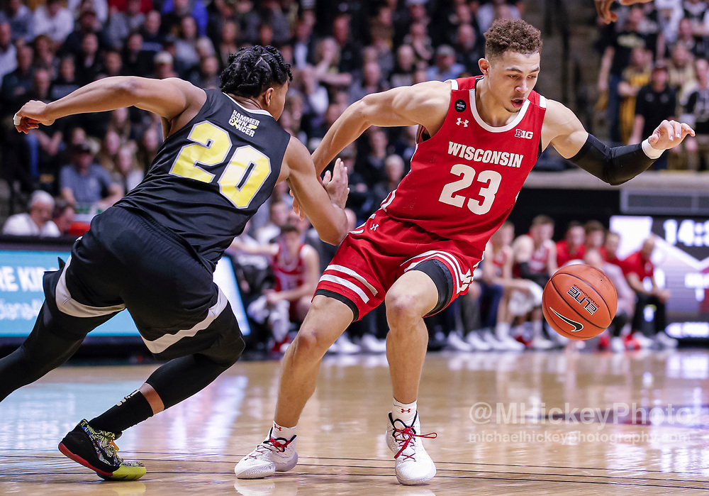 WEST LAFAYETTE, IN - JANUARY 24: Kobe King #23 of the Wisconsin Badgers loeses the handle on the ball as Nojel Eastern #20 of the Purdue Boilermakers defends at Mackey Arena on January 24, 2020 in West Lafayette, Indiana. (Photo by Michael Hickey/Getty Images) *** Local Caption *** Kobe King