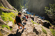 Hikers descending stairs on the Mist Trail, Yosemite National Park, California USA
