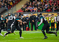 American Football - 2019 NFL Season (NFL International Series, London Games) - Houston Texans vs. Jacksonville Jaguars<br /> <br /> Gardner Minshew, Quarterback, (Jacksonville Jaguars) hands off to D.J Hayden, Defensive Back, (Jacksonville Jaguars) at Wembley Stadium.<br /> <br /> COLORSPORT/DANIEL BEARHAM