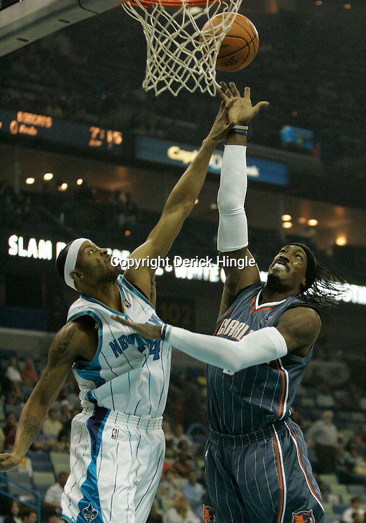 Apr 07, 2010; New Orleans, LA, USA; Charlotte Bobcats forward Gerald Wallace (3) shoots over New Orleans Hornets guard Morris Peterson (24)during the first half at the New Orleans Arena. Mandatory Credit: Derick E. Hingle-US PRESSWIRE