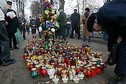 Placing votive candles in a Lodz, Poland cemetery on All Saints Day.