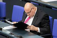 """25 MAR 2020, BERLIN/GERMANY:<br /> Peter Altmaier, CDU, Bundeswirtschaftsminister, liest in seinen Unterlagen, Bundestagsdebatte zu """"COVID 19 - Kreditobergrenzen, Nachtragshaushalt, Wirtschaftsfonds"""", Plenum, Reichstagsgebaeude, Deutscher Bundestag<br /> IMAGE: 20200325-01-037<br /> KEYWORDS: Pandemie, Corona, Sitzung, Debatte"""