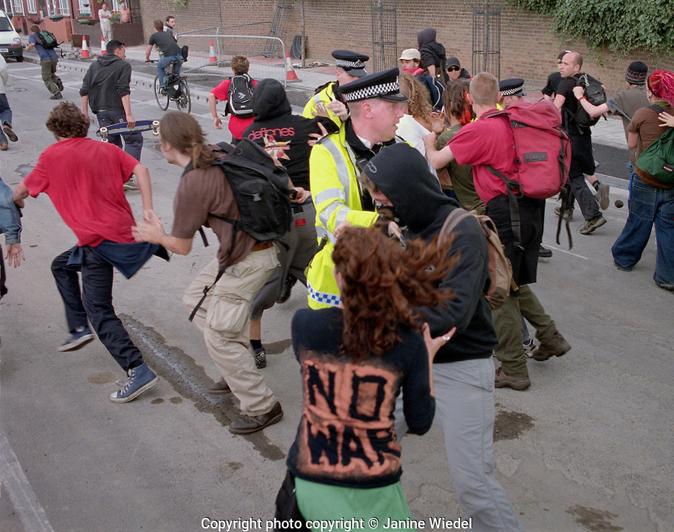 Confrontation between protesters and police outside Arms Trade Fair in Excel Center london 2003