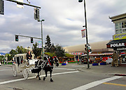 Alaska, Anchorage, Downtown Anchorage, Activity with a tour bus and a horsedrawn carriage, Fall