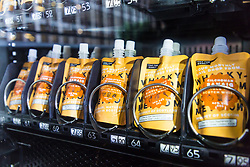 A whisky vending machine has been placed outside the Napoleon Hotel in Shoreditch which operates The Devil's Darling Cocktail Bar and a whisky Bar called Black Rock. Purchasers of tokens can buy pouches of rare and exclusive single malt whiskies, specially packaged in 1.7oz pouches branded Whisky Me. London, November 06 2018.