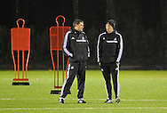 Swansea city Manager Garry Monk (right) during Swansea city FC team training in Landore, Swansea, South Wales on Wed 19th Feb 2014. the team are training ahead of tomorrow's UEFA Europa league match against Napoli.<br /> pic by Phil Rees, Andrew Orchard sports photography.