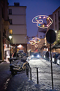 CLIMATE CHANGE. Snow, Arctic temperatures and big freeze in Paris, France. Christmas illuminations and night in and around Montmartre at night after the snow blizzard. Temperatures plummeted below zero, as low as -9. Very rarely, certainly not for decades, that Paris has experienced such freezing cold weather. Snow normally disappears in a couple of hours, this time it stuck around for days. Freak weather conditions and climate change can often be attributed to global warming and the ozone layer.