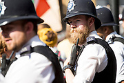 British police officers with traditional helmets. Over a quarter of a million people gathered in Central London to protest Donald Trump's presence in the UK to meet Queen Elizabeth and  Prime Minister Theresa May. London 13th July 2018 — Joana Saramago. // Mais de 250.000 juntaram-se em protesto no centro de Londres contra a visita oficial de Donald Trump ao Reino Unido. Londres, 13 Julho 2018. Joana Saramago.