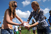 Resurrection High School senior Lauren McNeela, 17, and sophomore Melissa Anderson, 15, attempt to unravel a tightly-wound frozen t-shirt during a game at a back to school picnic celebrating the 90th anniversary of the all-girls College Prep school on Chicago's Northwest side on August 28, 2011 l Brian J. Morowczynski~ViaPhotos..For use in a single edition of Catholic New World Publications, Archdiocese of Chicago. Further use and/or distribution may be negotiated separately. ..Contact ViaPhotos at 708-602-0449 or email brian@viaphotos.com.   .