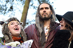 © Licensed to London News Pictures. 30/01/2016. Slough, UK. Russell Brand and Caroline Adams, 23,  at the formal opening of a wooden treehouse in memory of murder victim Alice Adams in Black Park, Wexham on Saturday 30th January. The 20-year-old was stabbed to death in August 2011 with her friend and co-worker Tibor Vass, at a staff flat behind the Radisson Edwardian Hotel near Heathrow Airport. The murderer was Attila Ban, aged 32,  who also worked at the hotel as a receptionist. After the death of Alice, her family created a charity called, Alice Adams Foundation, to raise money to build the treehouse. Photo credit should read: Emma Sheppard/LNP